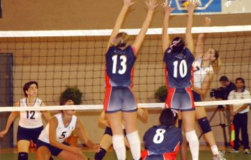 "031205-N-2468S-002 Catania, Sicily (Dec. 5, 2003) -- Members of U.S. Armed Forces WomenÕs Volleyball team blocks an Italian player from scoring during the 3rd Military World Games held in Catania, Sicily.  The Military World Games consists of 86 participating countries and were designed to promote ""Peace through Sports.Ó  U.S Navy photo by Photographer's Mate 2nd Class Terry Spain. (RELEASED)."